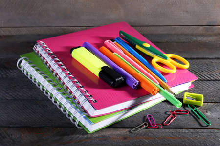 office supply: Colorful stationery on wooden background Stock Photo