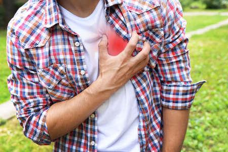 heartattack: Man having chest pain - heart attack, outdoors Stock Photo