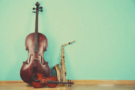 strings: Musical instruments on turquoise wallpaper background