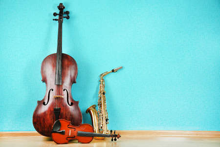 instruments: Musical instruments on turquoise wallpaper background