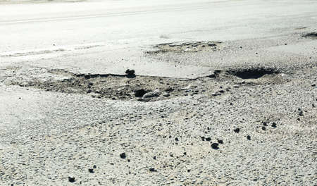 pit fall: Very bad quality road with potholes