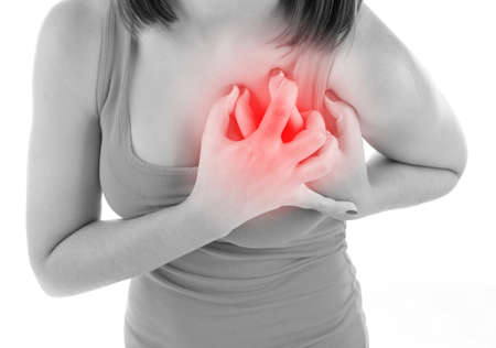 chest women: Woman having chest pain - heart attack, isolated on white