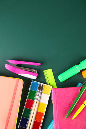 teaching crayons: Bright school supplies on blackboard background Stock Photo