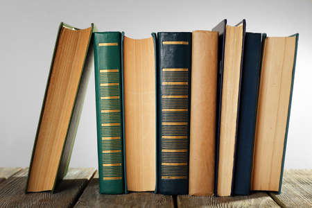books library: Old books on wooden table on gray background Stock Photo