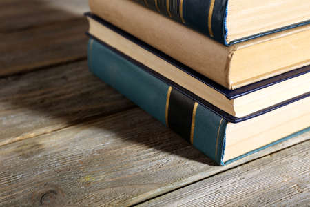 classics: Old books on wooden table, closeup