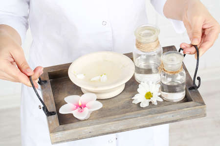 beauty therapist: Beauty therapist holding tray of spa treatments, close-up Stock Photo