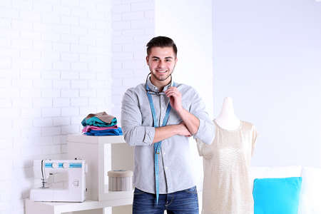 Young man fashion designer in studio Banque d'images