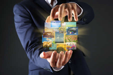 streaming: Businessman holding streaming images