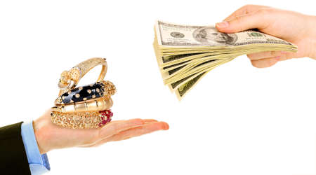 Jewelry and money on hands- pawnshop concept