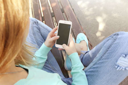 woman on phone: Woman with mobile phone, outdoors Stock Photo