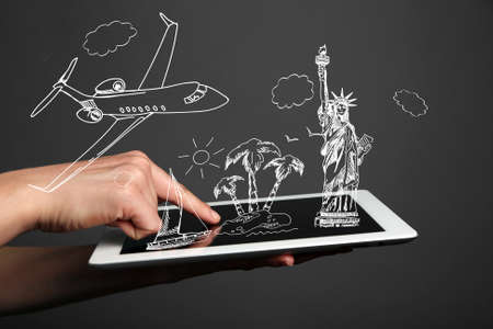 Concept of planning vacation - tablet pc with illustrations Stock Photo