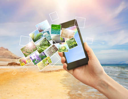 streaming: Hand holding smart phone with streaming images