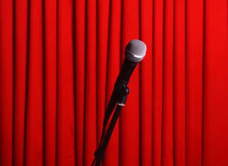 amplify: Microphone on stand on red curtain background Stock Photo