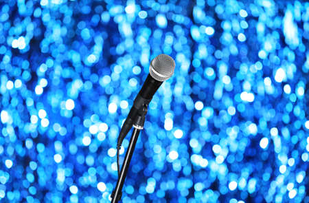 amplify: Microphone on stand on blue background Stock Photo