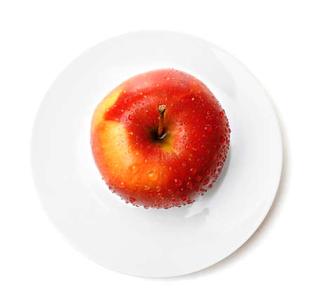 Apple on saucer isolated on white Archivio Fotografico