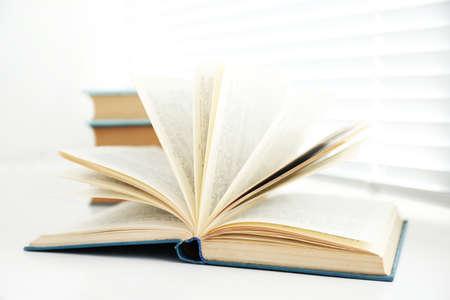windowsill: Books on white windowsill, close up