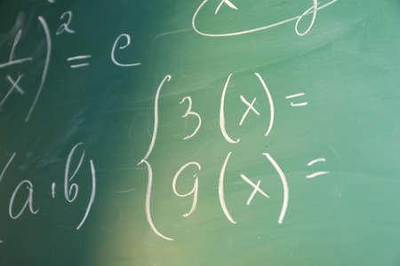 Mathematics formulas on blackboard background