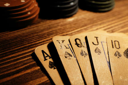 poker: Playing cards with chips on wooden table, closeup Stock Photo