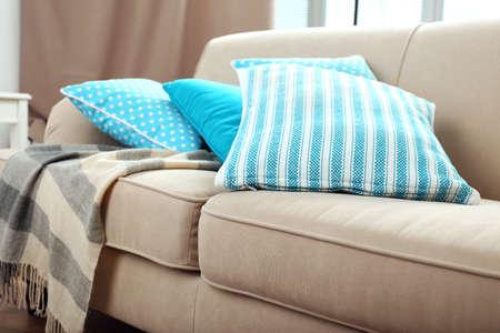 sofa: Interior design with pillows on sofa, closeup