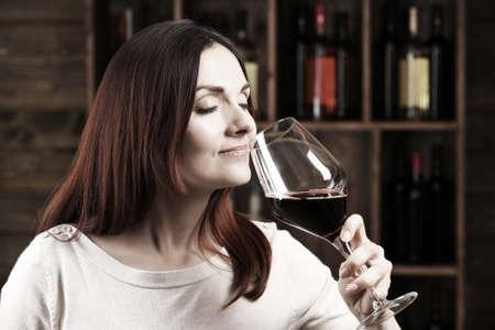 Portrait of beautiful woman drinking wine, black and white retro stylization Stock Photo