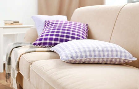 couches: Interior design with pillows on sofa, closeup