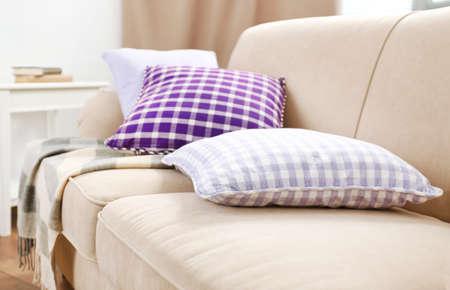 couches: Interior design with pillows on sofa, closeup