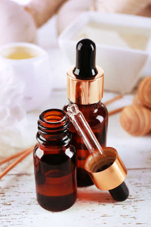 essence: Spa dropper bottles with essence on wooden table, closeup
