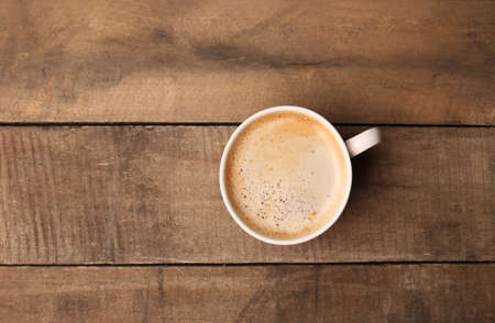 Cup of coffee on wooden table, top view Stock fotó - 47037124