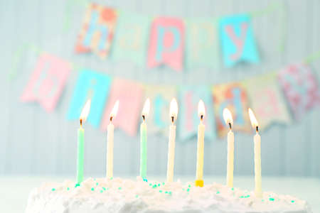 birthday decoration: Birthday cake with candles on planks wall background