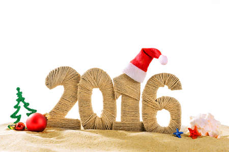 merry: New year 2016 sign on beach sand