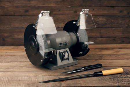 sharpening process: Knife sharpener on wooden background