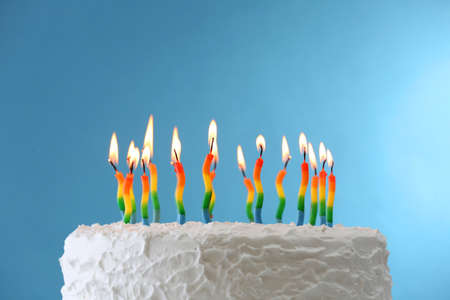 happy birthday cake: Birthday cake with candles on color background Stock Photo