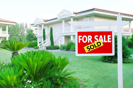 real estate sign: Real estate sign in front of new house for sale Stock Photo