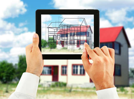 exterior house: Architect showing new house project on tablet-pc, close up