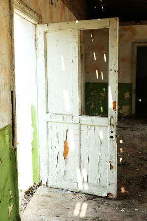 vandal: Old wooden door in abandoned house Stock Photo