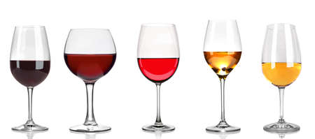 Set of white, rose, and red wine glasses, isolated on white