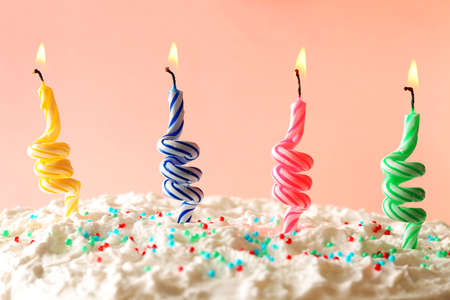 party pastries: Birthday cake with candles on color background Stock Photo