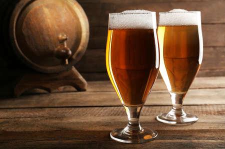 unbottled: Glasses of beer on wooden background