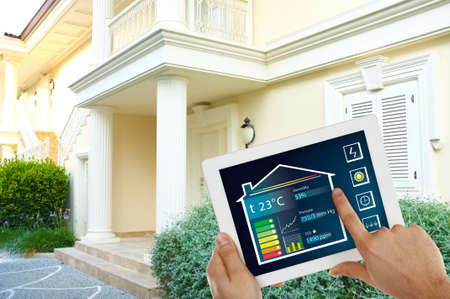 touchscreen: Smart energy controller or remote home control online on tablet-pc