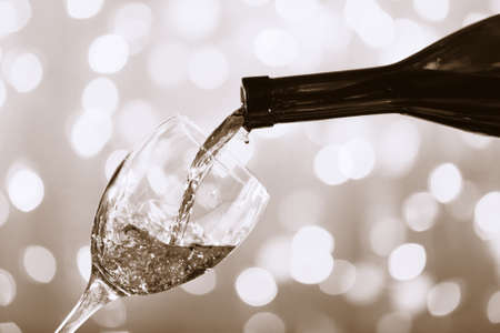stylization: Wine pouring into glass,  black and white retro stylization