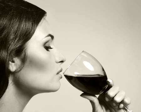 Portrait of beautiful woman drinking wine, black and white retro stylization 스톡 콘텐츠