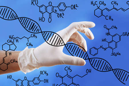 Young doctor working with drawing DNA molecule Stock Photo