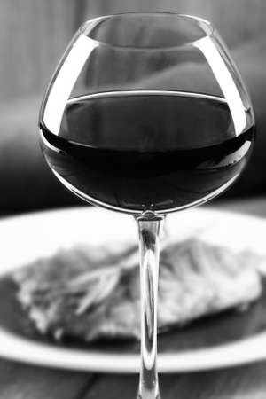 stylization: Glass of red wine and dinner,  black and white retro stylization