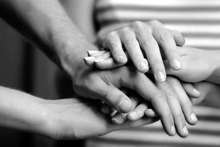 group of hands: United hands close up.  Black and white retro stylization