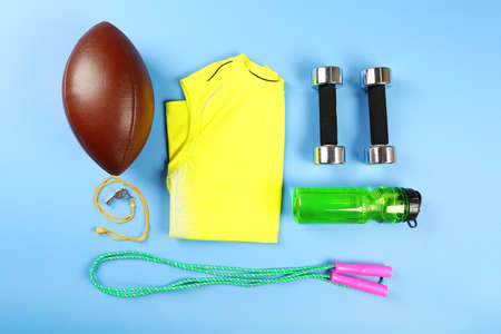 handball: Sports equipment and T-shirt on color table, top view
