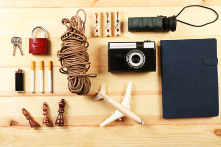 travel gear: Travel gear on wooden table, top view