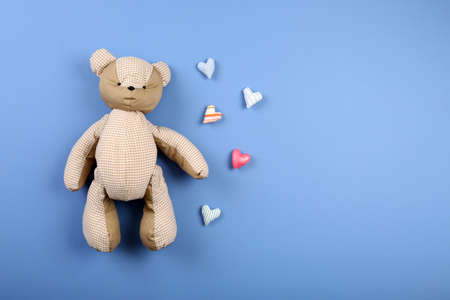 love toys: Handmade toys on color table, top view
