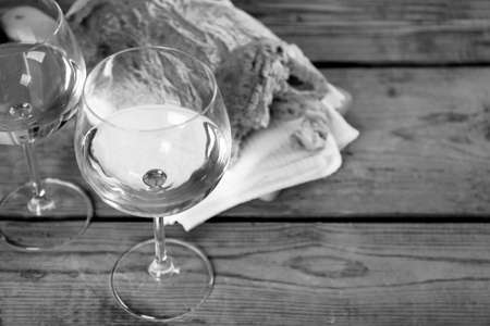 stylization: Still life of wine and bread,  black and white retro stylization
