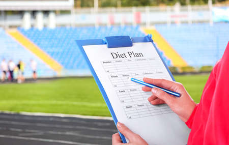 personal: Sports trainer with personal workout plan Stock Photo