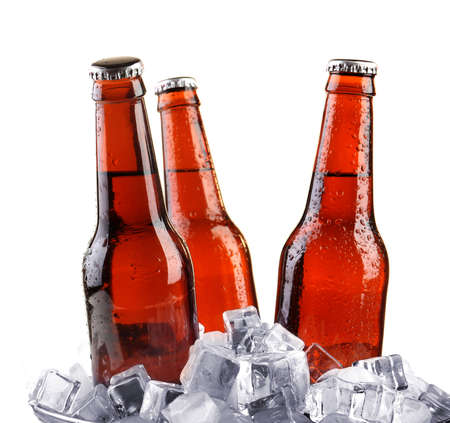 dew cap: Glass bottles of beer isolated on white